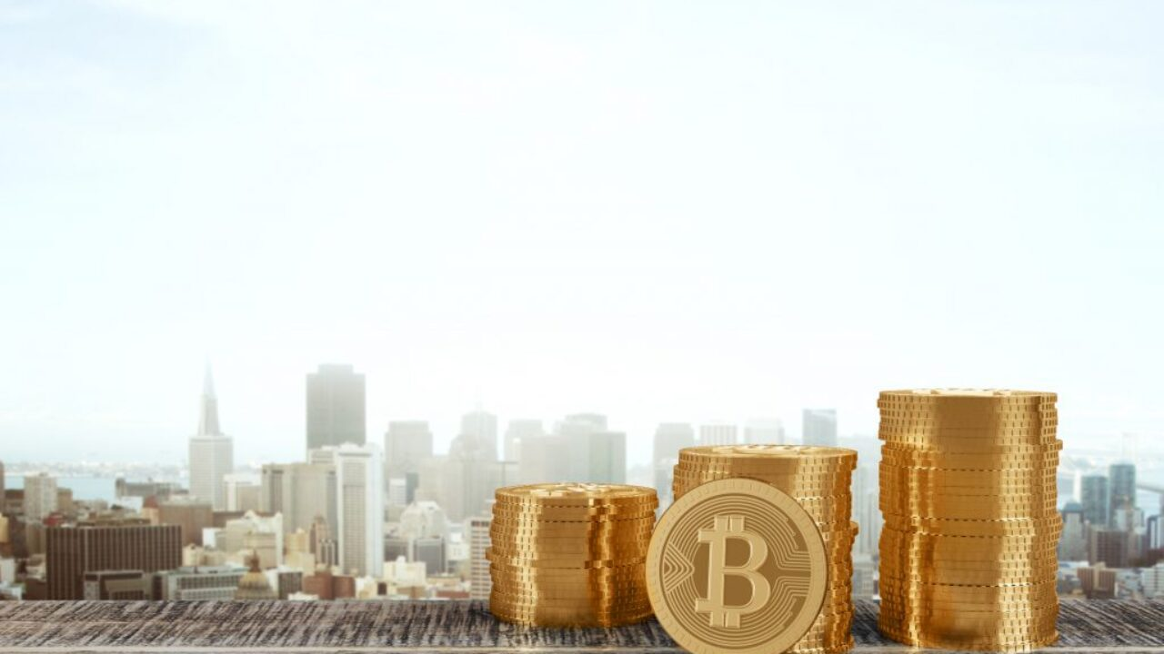 Golden bitcoins with city view